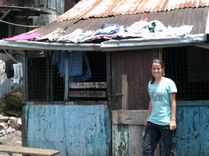 Kristin in front of her house.